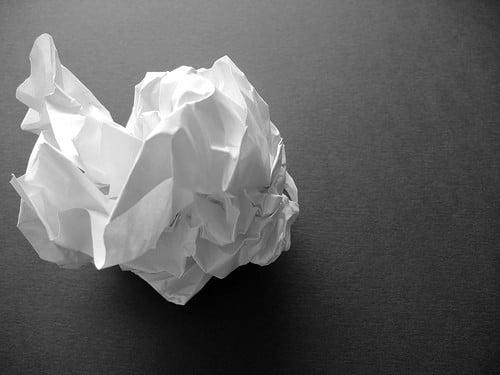 Prop papier. Aan één zijde deels betypt.